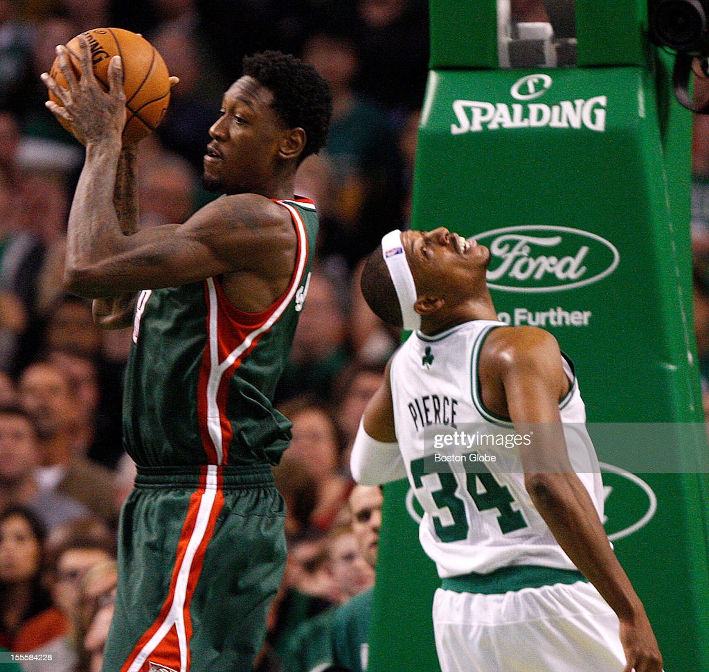 Boston Celtics small forward Paul Pierce (#34) looks back after his shot was blocked and Milwaukee Bucks power forward Larry Sanders (#8) pulled down the rebound during the fourth quarter as the Boston Celtics play the Milwaukee Bucks in their season home opener at TD Garden.