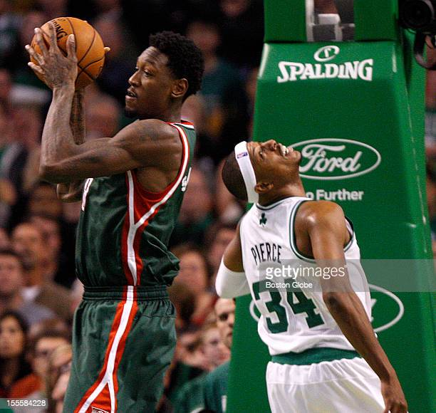 Boston Celtics small forward Paul Pierce looks back after his shot was blocked and Milwaukee Bucks power forward Larry Sanders pulled down the...