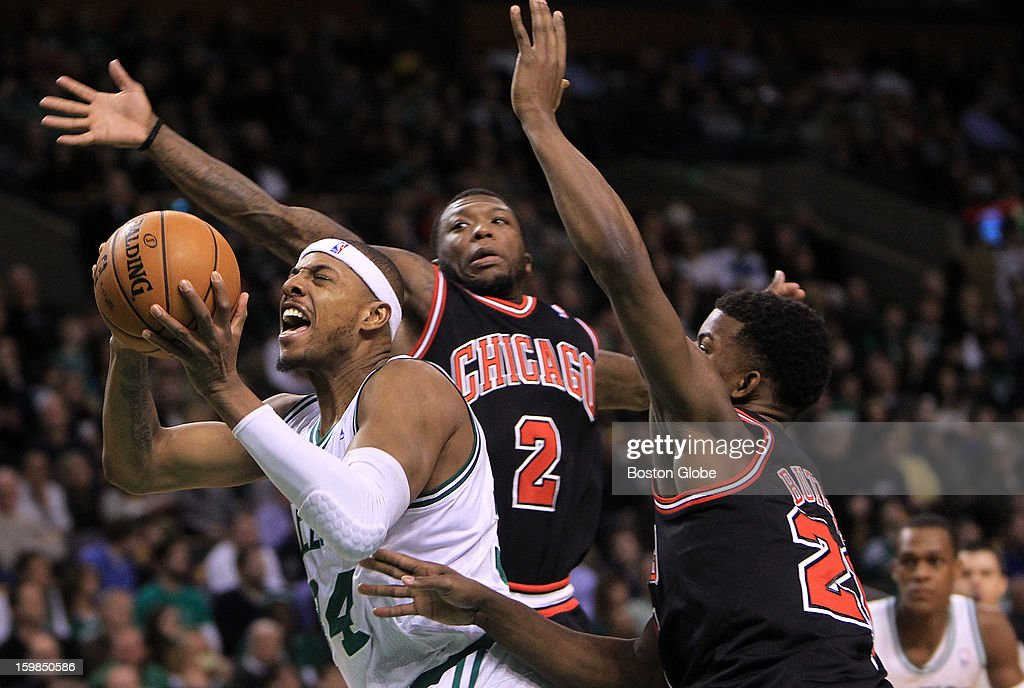 Boston Celtics small forward Paul Pierce (#34) splits the double team of Chicago Bulls point guard Nate Robinson (#2) and Chicago Bulls small forward Jimmy Butler (#21) in the first half as the Boston Celtics play the Chicago Bulls at TD Garden.