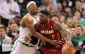Boston Celtics small forward Paul Pierce tries to block Miami Heat small forward LeBron James in the first quarter Boston Celtics NBA basketball...