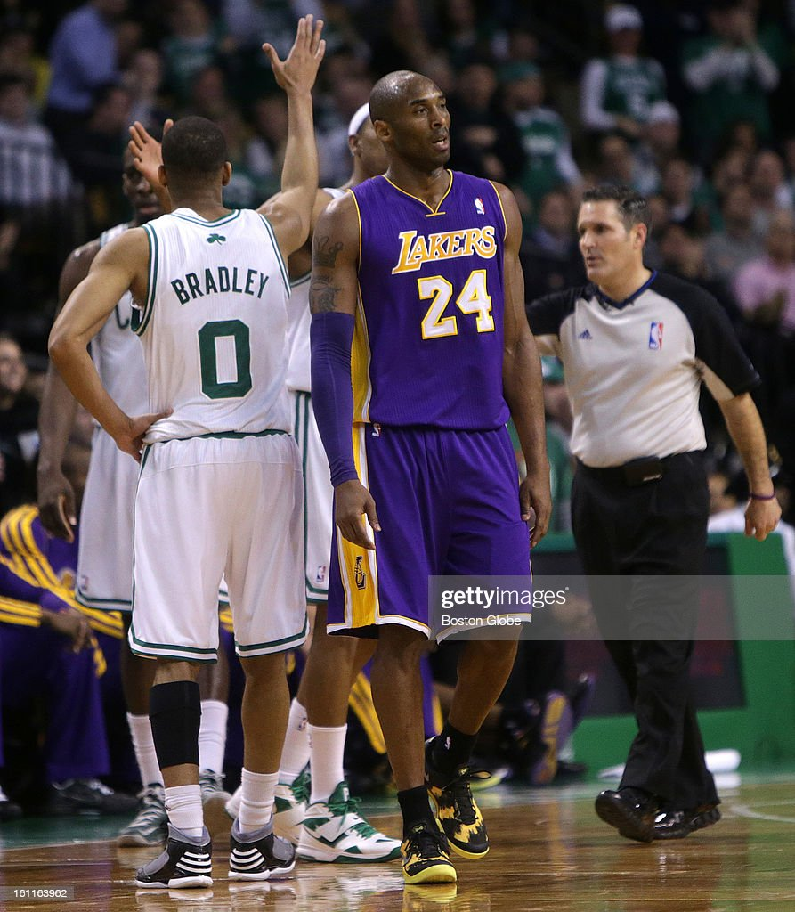 Boston Celtics small forward Paul Pierce (#34) was celebrating after drawing the foul call but Los Angeles Lakers shooting guard Kobe Bryant (#24) wasn't happy as the Boston Celtics play the Los Angeles Lakers at TD Garden.