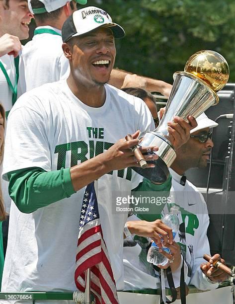 Boston Celtics team captain Paul Pierce holds the 2008 NBA Finals MVP trophy and a victory cigar during the 2008 NBA World Champion Boston Celtics...