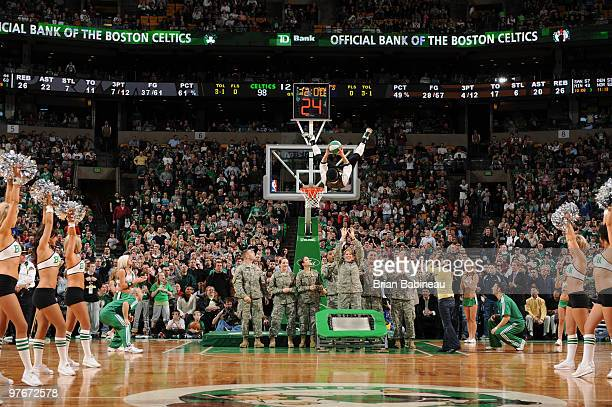 Boston Celtics team mascot Lucky dunks the ball during halftime with members of the US Military in a game against the Indiana Pacers on March 12 2010...