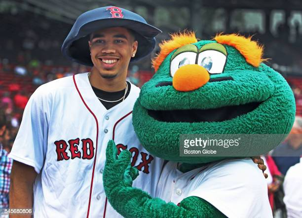 Boston Celtics top pick as well as the third player taken overall in the NBA Draft Jayson Tatum poses with Red Sox mascot Wally while trying on an...