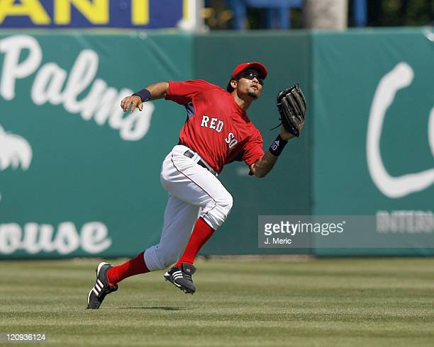 Boston center fielder Coco Crisp looks to make the play during Sunday's game against Florida at City of Palms Park in Ft Myers Florida on March 25...