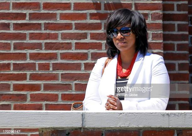 Boston City Councilor Ayanna Pressley pauses on the balcony of the church after attending a memorial mass in honor of Martin Richard at Saint Ann...