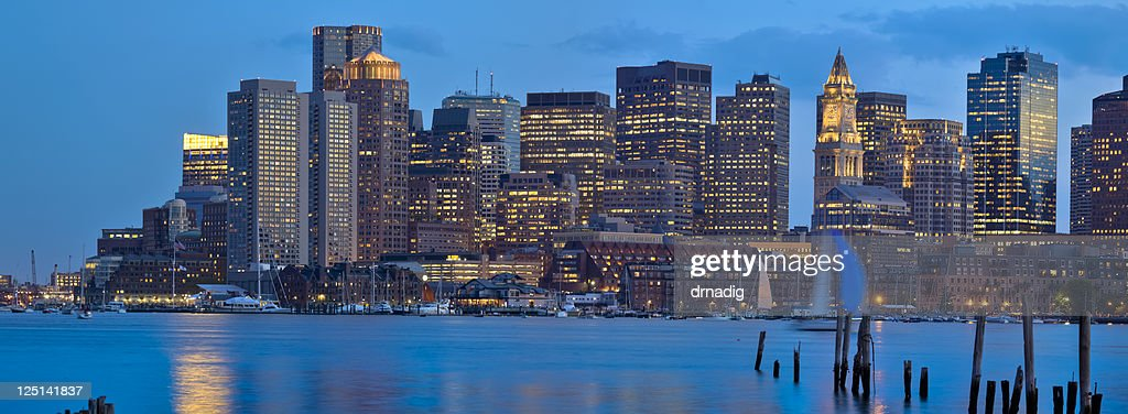 Boston Cityscape With Skyscrapers Aglow After Dark - Panorama : Stock Photo