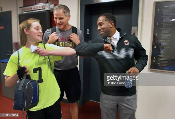 Boston College Athletic Director Martin Jarmond right greets Eagles' Women's Basketball head coach Erik Johnson center and his daughter Avery Johnson...