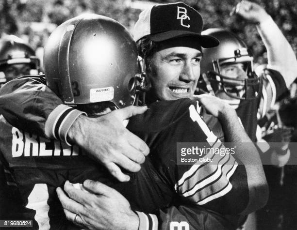 Boston College coach Jack Bicknell hugs wide receiver Brian Brennan after BC defeated Penn St in a game at Sullivan Stadium in Foxborough Mass on Oct...