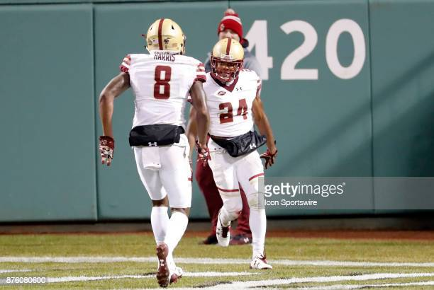 Boston College defensive back William Harris rushes to congratulate Boston College defensive back TajAmir Torres after his pick six touchdown during...