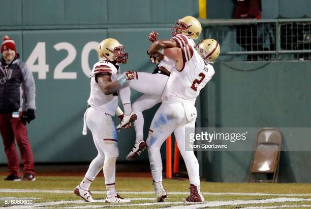 Boston College defensive end Zach Allen hoists Boston College defensive back TajAmir Torres into the air after his pick six touchdown during a game...