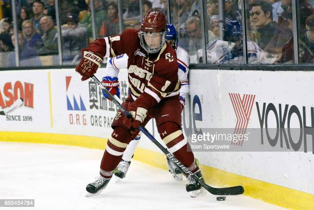 Boston College Eagles defenseman Jesper Mattila plays the puck back to the point during the Hockey East Championship game between the UMass Lowell...