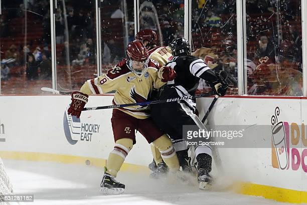 Boston College Eagles defenseman Jesper Mattila ties up Providence College Friars forward Erik Foley during a Frozen Fenway NCAA Men's Division 1...