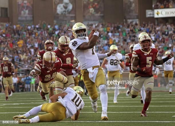 Boston College Eagles defensive back TajAmir Torres makes a last ditch dive for Notre Dame Fighting Irish quarterback Brandon Wimbush who ran 65...