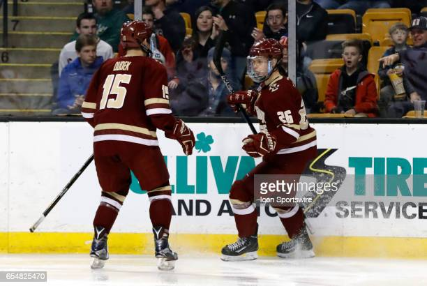 Boston College Eagles forward JD Dudek rushes in to help Boston College Eagles forward Julius Mattila celebrate his goal during a Hockey East...