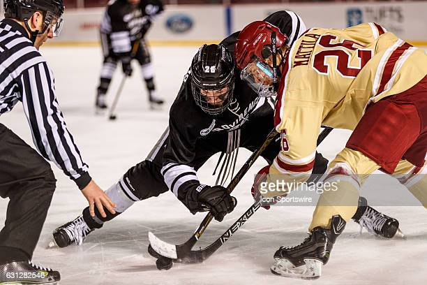 Boston College Eagles forward Julius Mattila and Providence College Friars forward Brian Pinho face off during the third period of the game between...