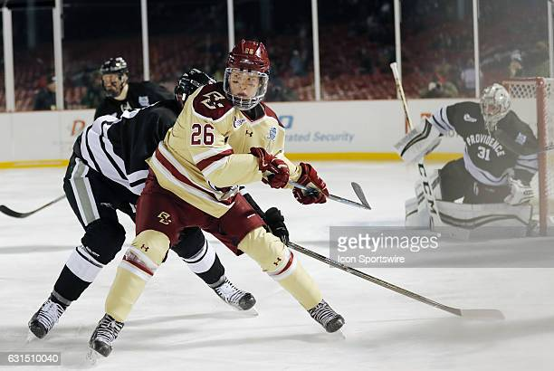 Boston College Eagles forward Julius Mattila looks back for a pass during a Frozen Fenway NCAA Men's Division 1 hockey game between the Boston...