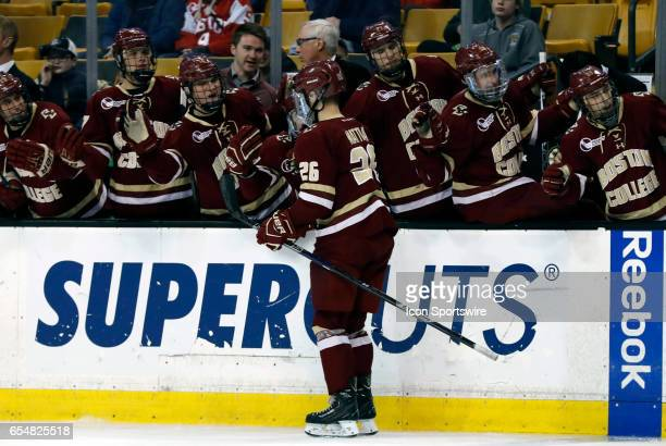 Boston College Eagles forward Julius Mattila skates by the bench after opening the scoring during a Hockey East semifinal between the Boston...