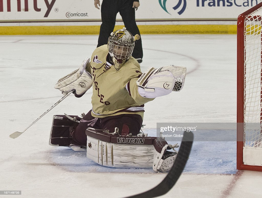 Boston College Eagles goalie Parker Milner makes a glove save against Northeastern University Huskies during second period action at Conte Forum on Saturday, Oct. 20, 2012.