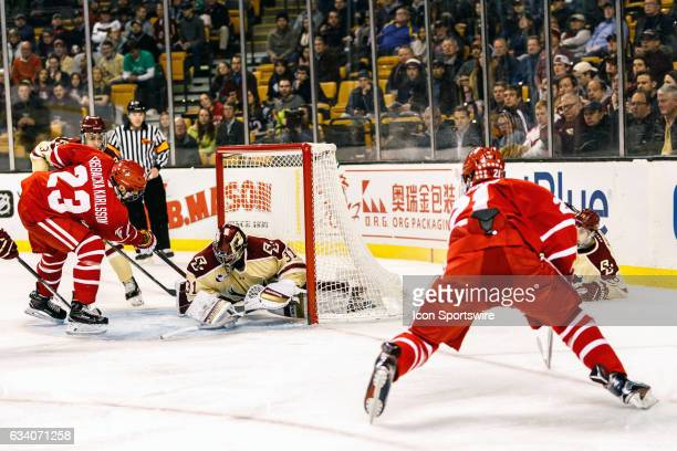 Boston College Eagles goaltender Joseph Woll blocked the shot by Boston University Terriers forward Patrick Harper but can't stop Terrier forward...