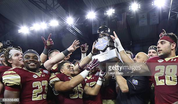 Boston College Eagles head football coach Steve Addazio celebrates a win over the Maryland Terrapins to win the 2016 Quick Lane Bowl Game at Ford...