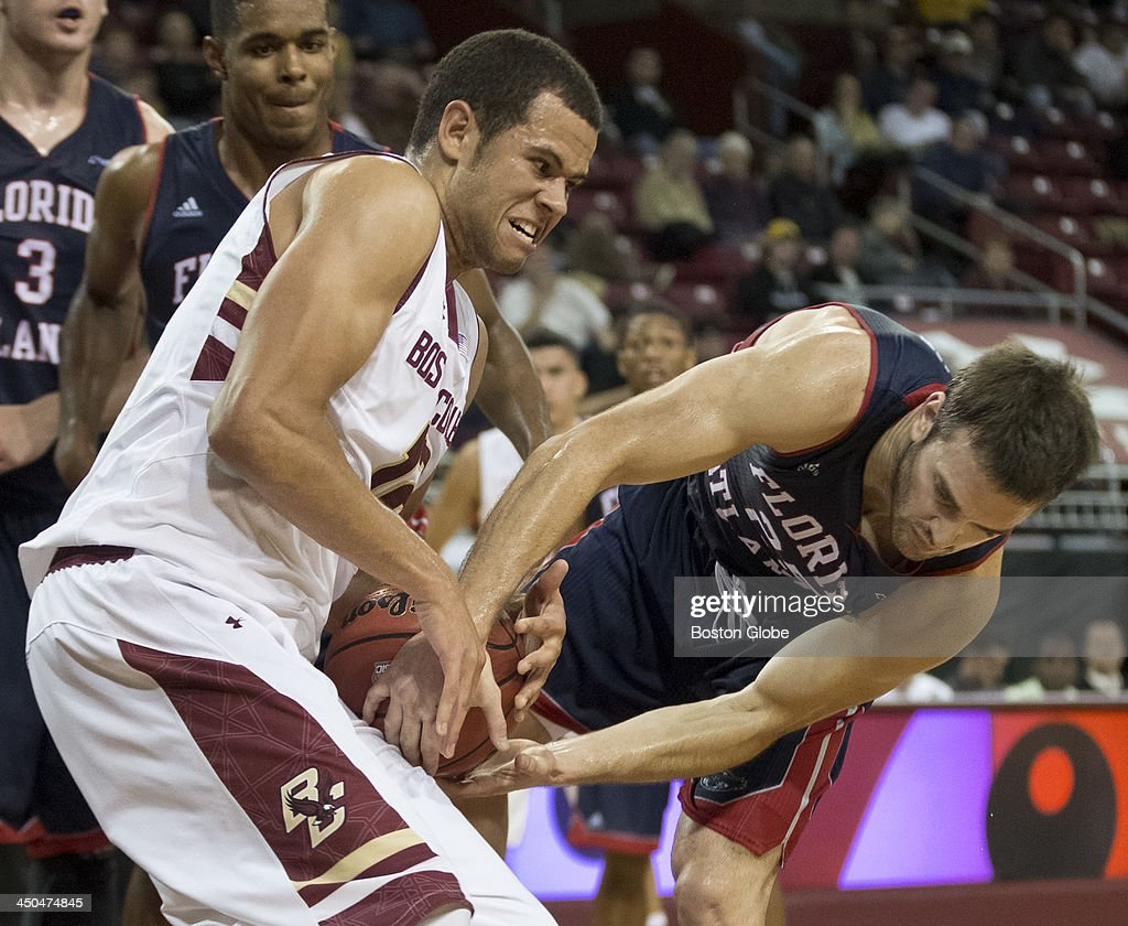 Boston College Eagles men's basketball player Ryan Anderson battles for a rebound with Florida Atlantic Owls player Pablo Bertone during first half...