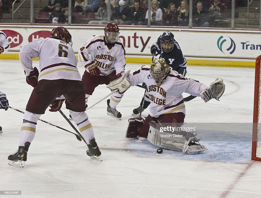 Boston College Eagles men's ice hockey goalie Parker Milner makes a save against the Yale University Bulldogs during second period action at Conte Forum on Friday, Jan. 4, 2012.