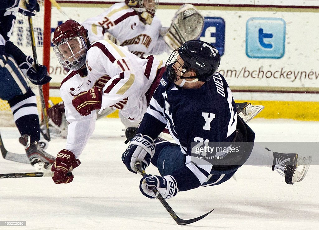 Boston College Eagles men's ice hockey player Pat Mullane checks Yale University Bulldogs player Colin Dueck during first period action at Conte Forum on Friday, Jan. 4, 2012.