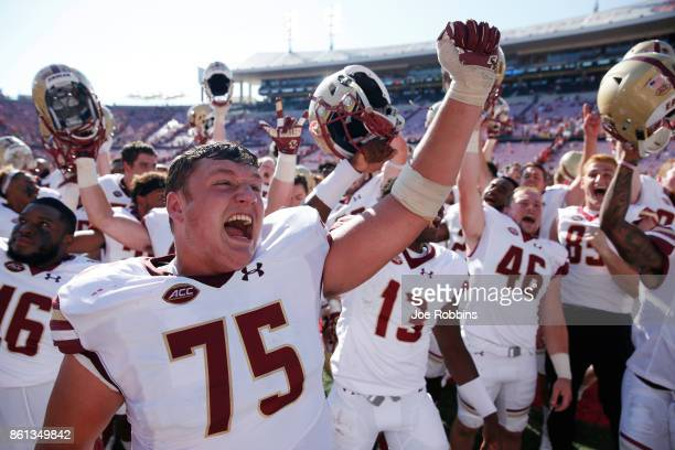 Boston College Eagles players celebrate after a 4542 win over the Louisville Cardinals in a game at Papa John's Cardinal Stadium on October 14 2017...