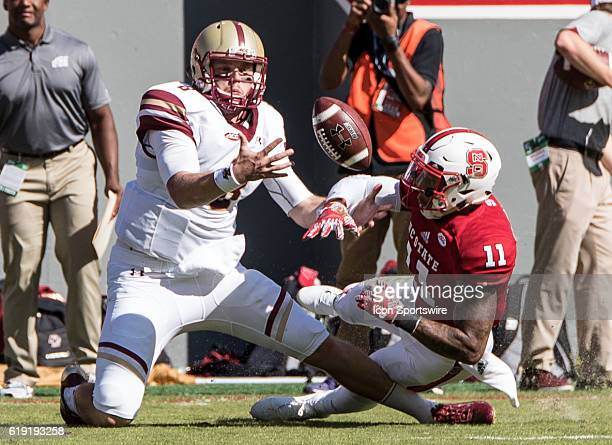 Boston College Eagles quarterback Patrick Towles attempts to catch a pass while defended by NC State Wolfpack safety Josh Jones in the first half...
