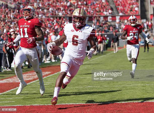 Boston College Eagles wide receiver Jeff Smith scores with NC State Wolfpack safety Josh Jones and NC State Wolfpack safety Shawn Boone looking on in...