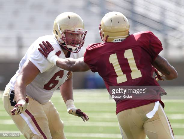 Boston College football player Aaron Monteiro left is pictured at a morning practice session in Newton MA on Aug 10 2017