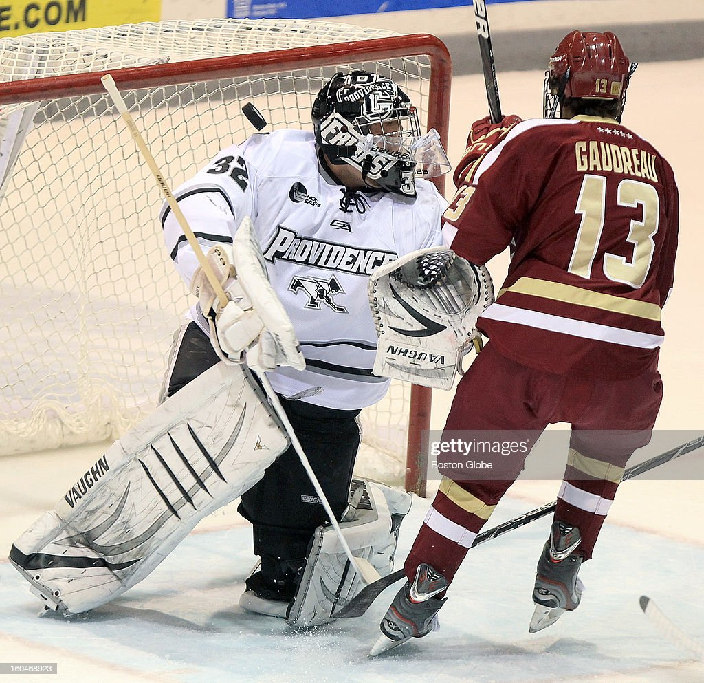 Boston College forward Johnny Gaudreau (#13) scores the only goal of the first period on Providence College goaltender Jon Gillies (#32). Boston College men's ice hockey. BC plays Providence College at Schneider Arena in Providence, R.I.