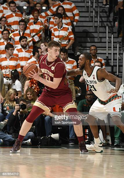 Boston College forward Nik Popovic is guarded by Miami forward Kamari Murphy during an NCAA basketball game between the Boston College Eagles and the...