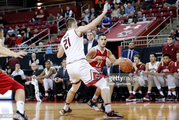 Boston College forward Nik Popovic tries to cut off Sacred Heart guard Sean Hoehn during a game between the Boston College Eagles and the Sacred...