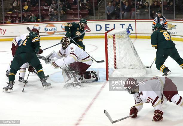 Boston College goalie Joseph Woll is out of position as University of Vermont's Brian Bowen makes a game tying wrap around goal during the second...