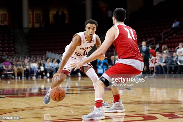 Boston College guard Jerome Robinson makes a move on Sacred Heart forward Joseph Lopez during a game between the Boston College Eagles and the Sacred...