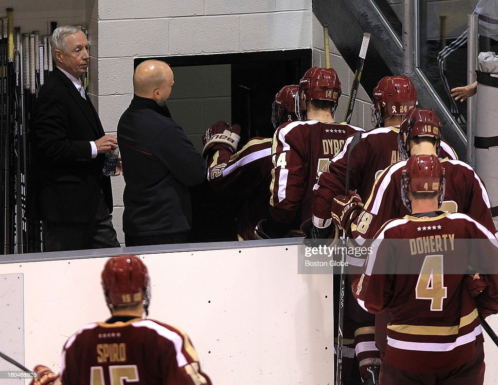 Boston College head coach Jerry York and the team head for the locker room after having to settle for a 3-3 tie at Providence. Boston College men's ice hockey. BC plays Providence College at Schneider Arena in Providence, R.I.