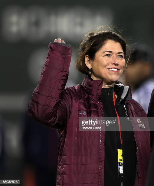 Boston College High School headmaster Grace Regan waves as she is introduced on the field before the start of a football game between Boston College...