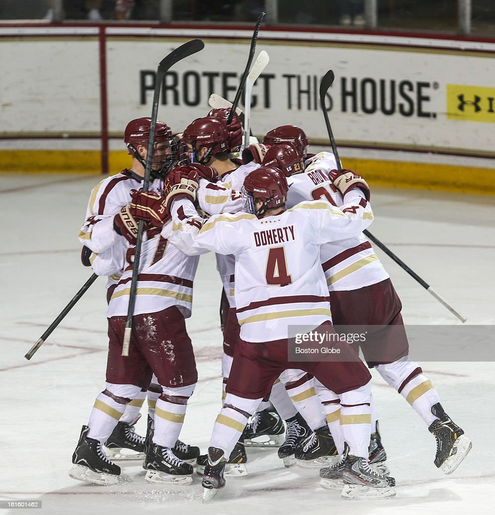 Boston College players celebrate after their second goal in the second period scored by Quinn Smith (#27) during a hockey game between Boston College and the University of Vermont at Conte Forum in Chestnut Hill.