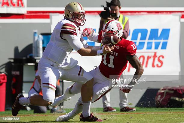 Boston College quarterback Patrick Towles drops a pass while defended by NC State safety Josh Jones during the first half between the Boston College...