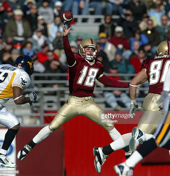Boston College quarterback Paul Peterson attempts to defy gravity as he looks for an open man against West Virginia during a game between the Boston...