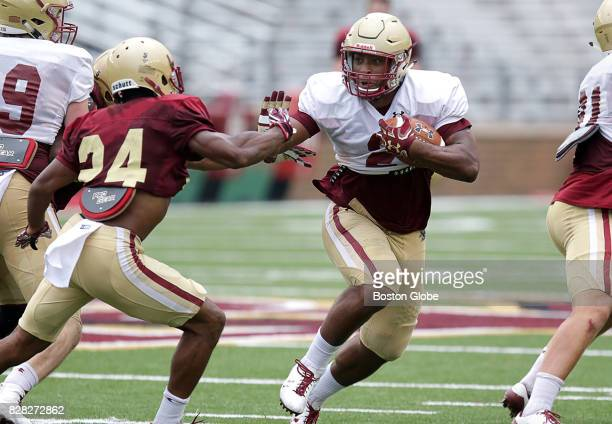 Boston College running back AJ Dillion right is pictured during football practice in Newton MA on Aug 8 2017