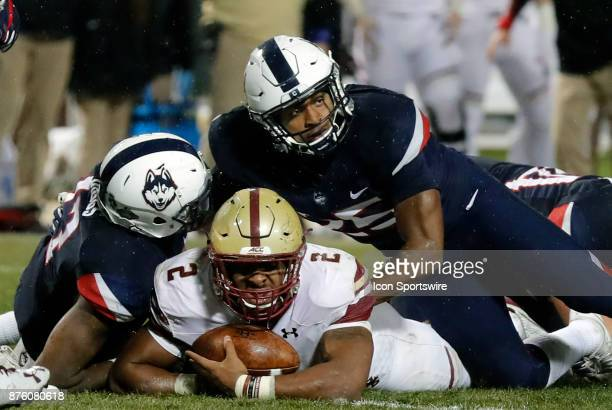 Boston College running back AJ Dillon comes up just short of the goal line tackled by UConn Huskies defensive back Jamar Summers and UConn Huskies...