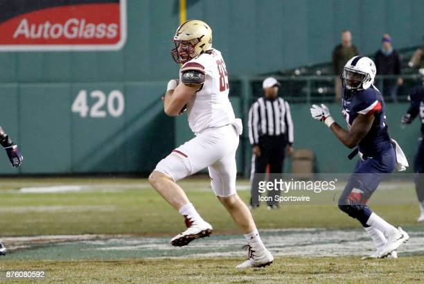 Boston College tight end Tommy Sweeney turns after a catch over the middle during a game between the UCONN Huskies and the Boston College Eagles on...