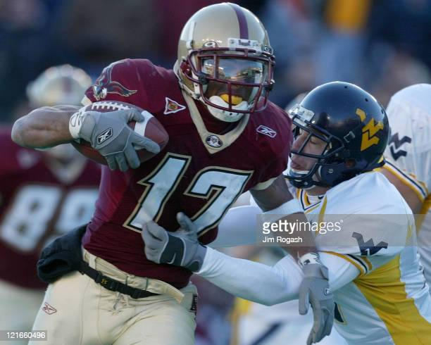 Boston College wide receiver Joel Hazard left feels the pressure of West Virginia's free safety Brian King right during a game between the Boston...