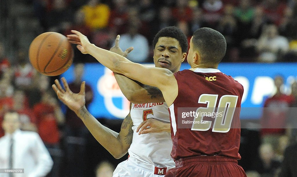 Boston College's Lonnie Jackson (20) knocks the ball away from Maryland's Nick Faust in the first half at Comcast Center in College Park, Maryland, on Tuesday, January 22, 2013.