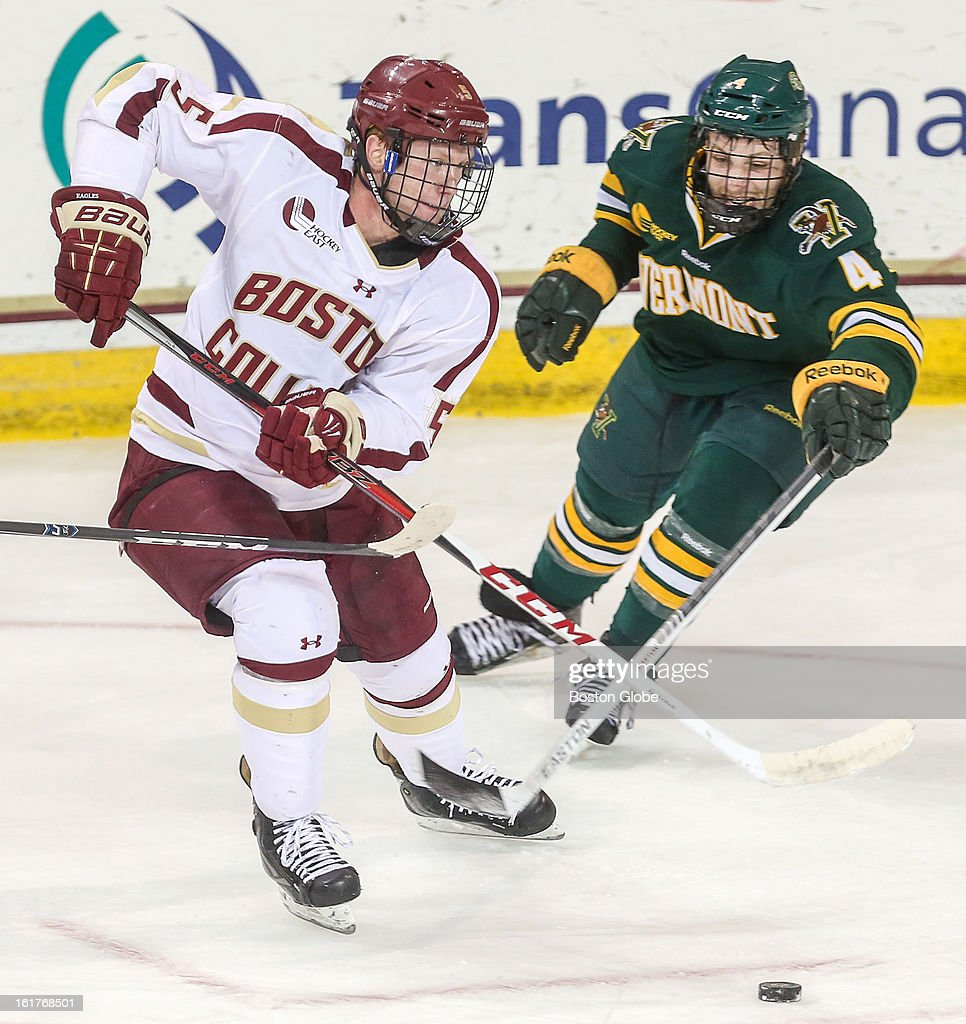 Boston College's Michael Matheson (#5) skates past Vermont's Nick Bruneteau (#4), during a hockey game between Boston College and the University of Vermont at Conte Forum in Chestnut Hill.