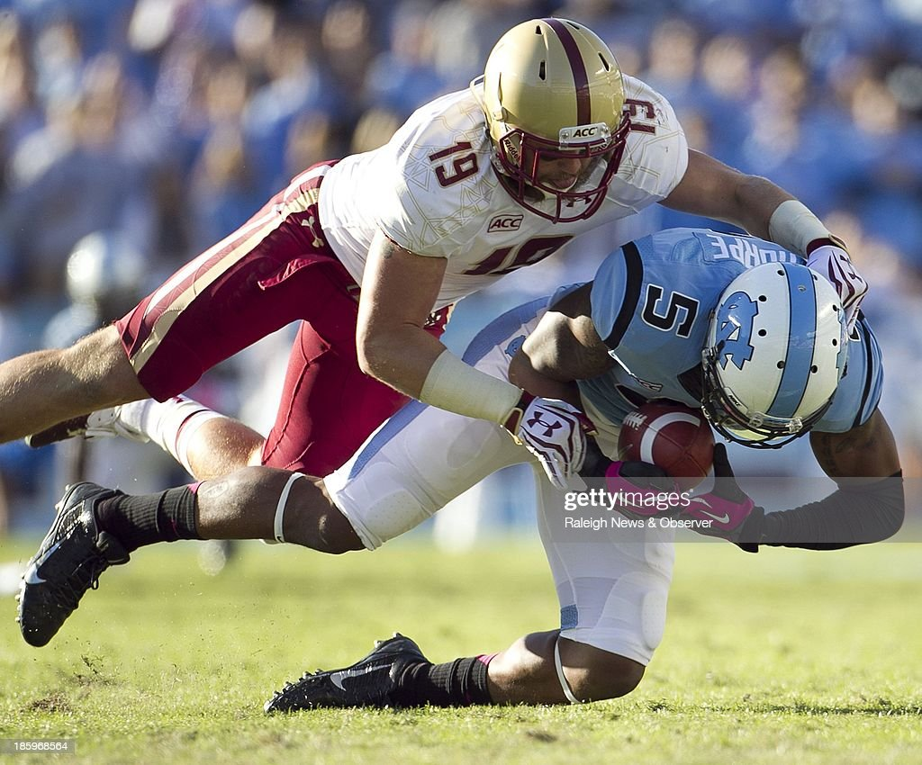 Boston College's Sean Sylvia (19) stops North Carolina's T.J. Thorpe (5) on a 33-yard pass completion in the second quarter at Kenan Stadium in Chapel Hill, North Carolina, on Saturday, October 26, 2013.