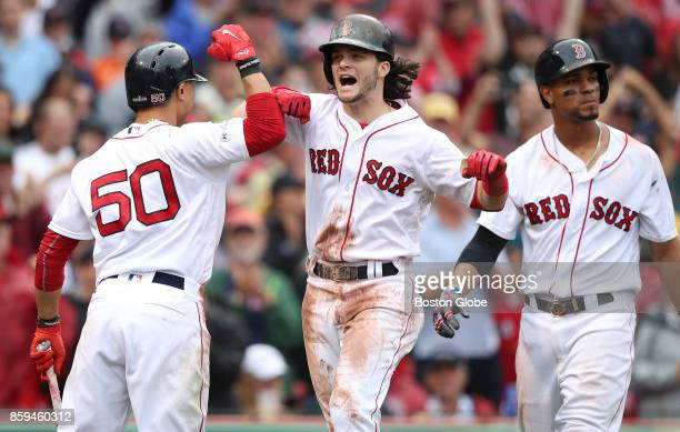 Boston ed Sox Andrew Benintendi celebrates with teammates Mookie Betts and Xander Bogaerts after his tworun home run in the fifth inning The Boston...